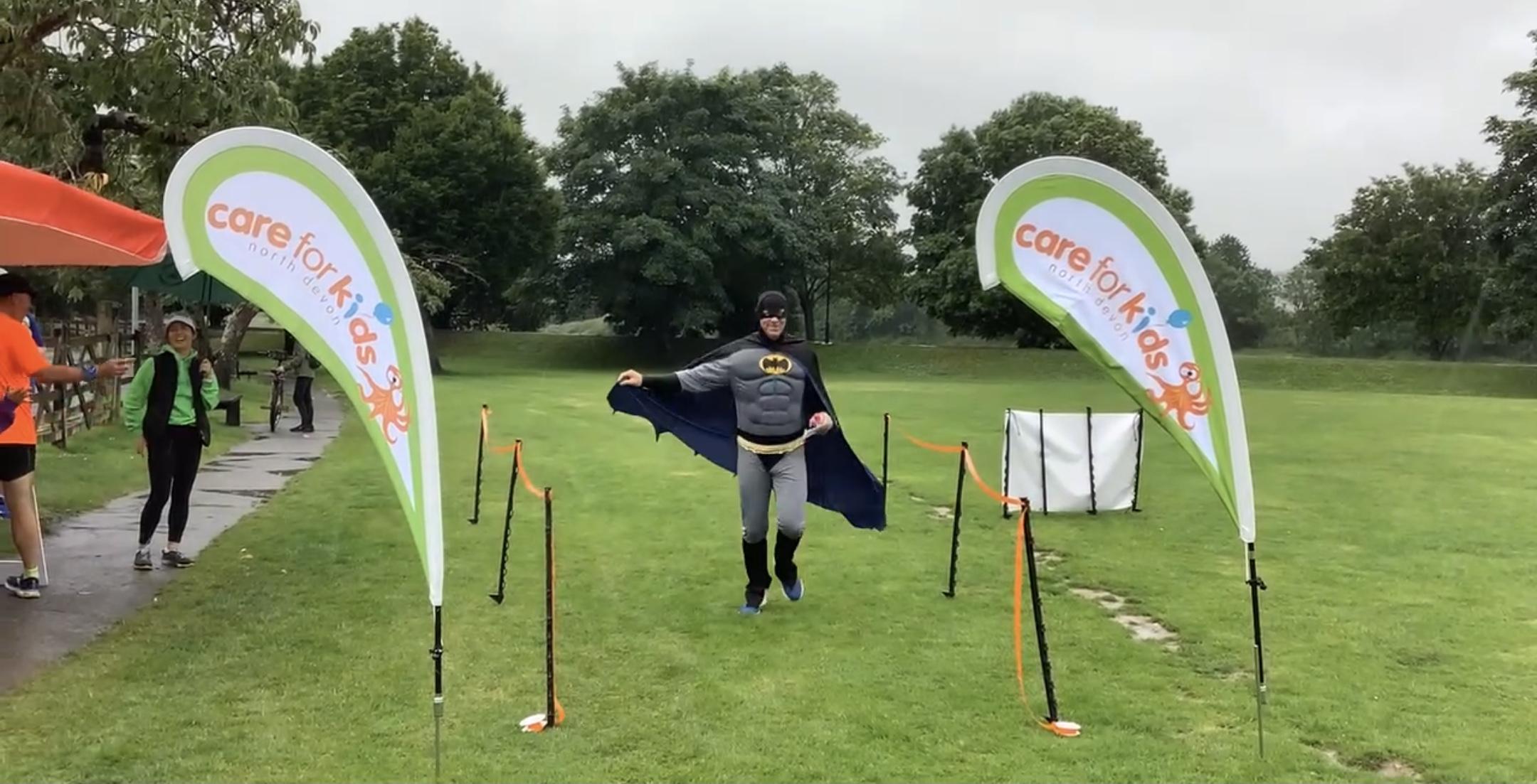 A runner dressed in a batman costume